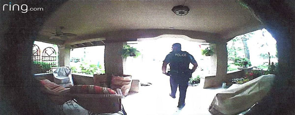 Ring camera screenshot of police officer on front porch